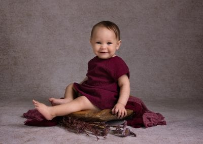 Child Photography Little girl sitting on wooden bowl - Tianna J-Williams Photography
