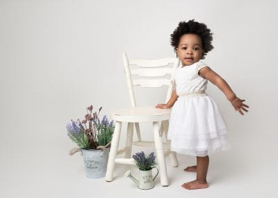 Toddler standing whilst posing