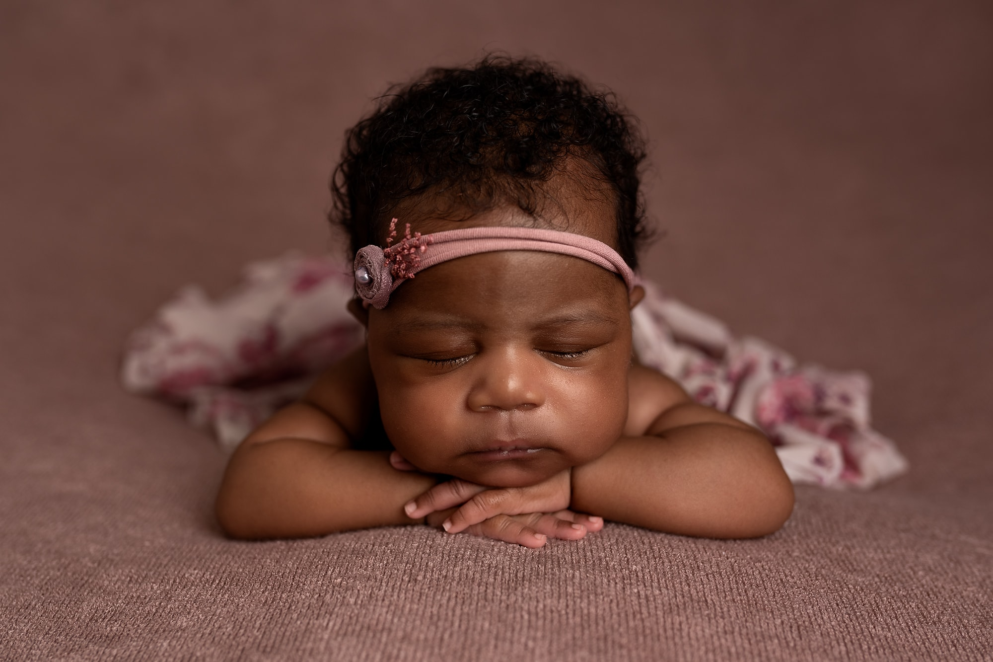 Newborn Baby Girl Wrapped in Dusky Pink Coloured Wrap, newborn photography session.