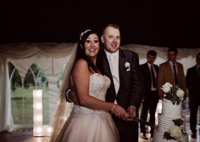 Couple Cutting the Cake Grafton Manor Tianna J-Williams Wedding Photogtaphy