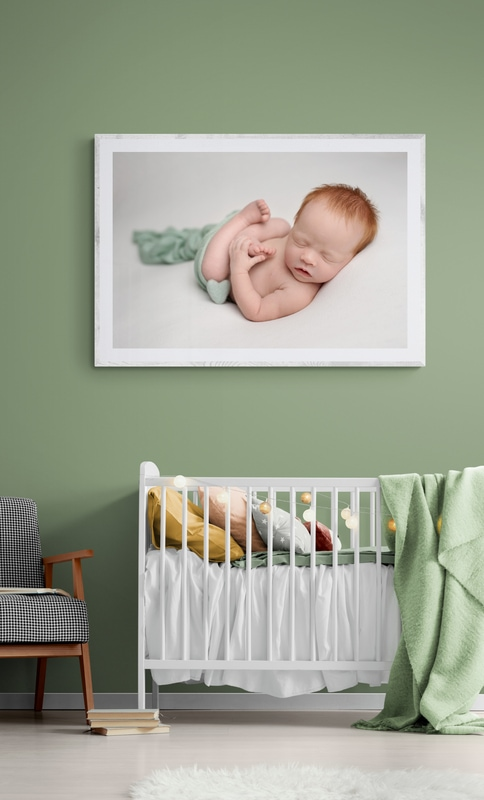 Framed Photograph of Newborn Baby in Baby's Nursery By Tianna J-WIlliams Photograpghy